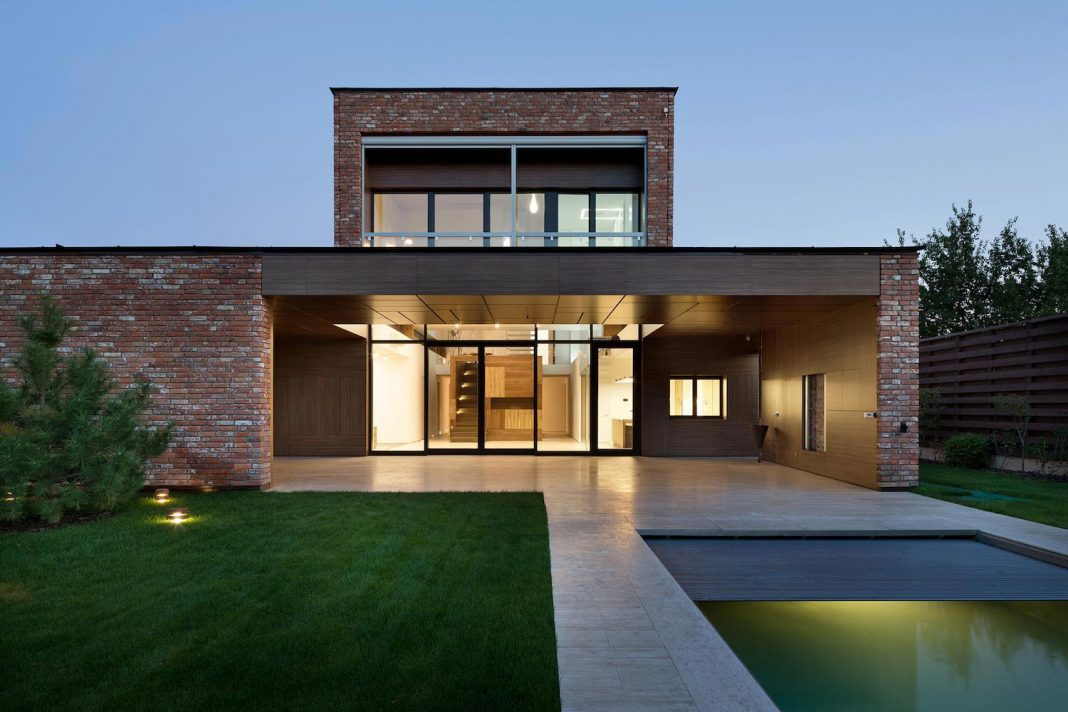 Modern home built by recycled second hand bricks reclaimed for Modern house design with bricks