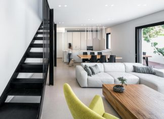 Modern renovation of a single-story, semi-detached house from the 1950's