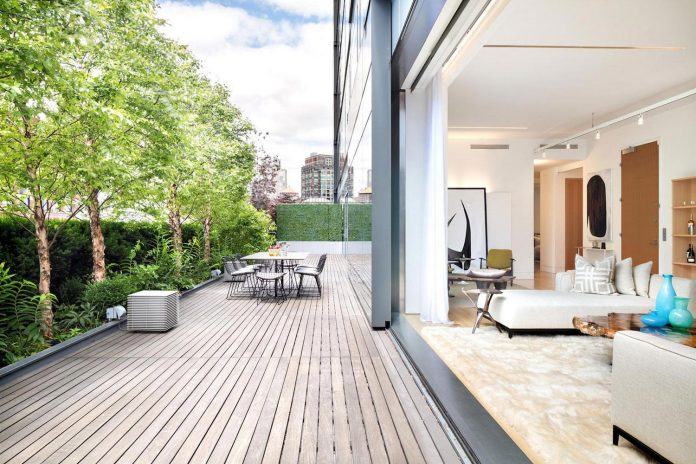 Penthouse in New York imbued with a sense of universal, open-ended tranquility and warmth