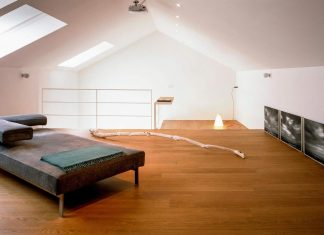 Simple and practical home, a restoration of an old house attic in front of the sea