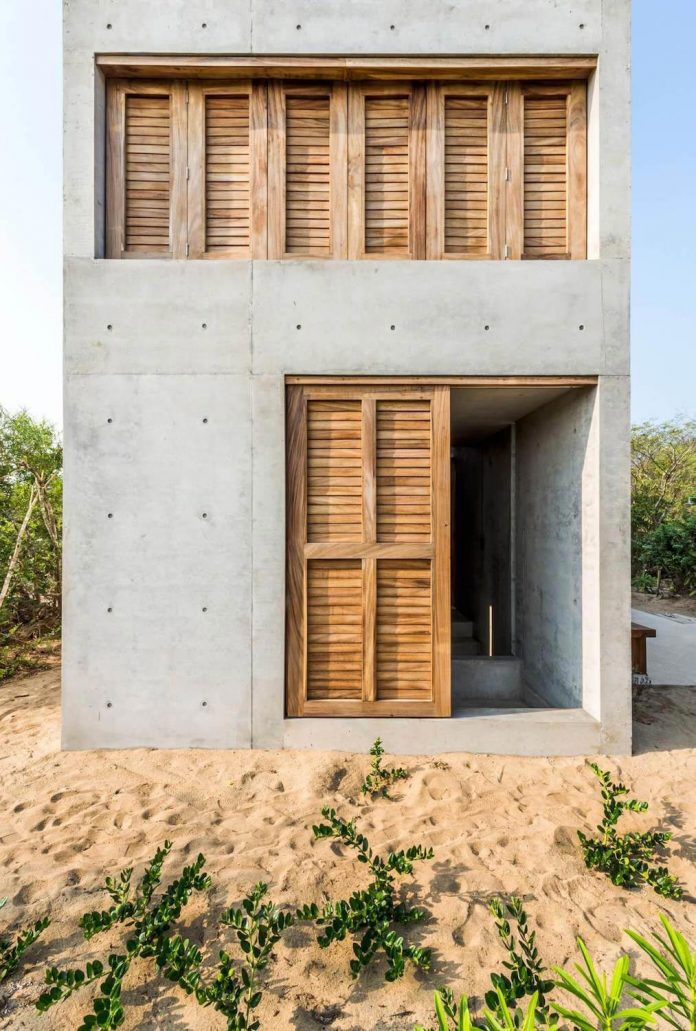 Small House For Two Nested In Area Of Dense Vegetation