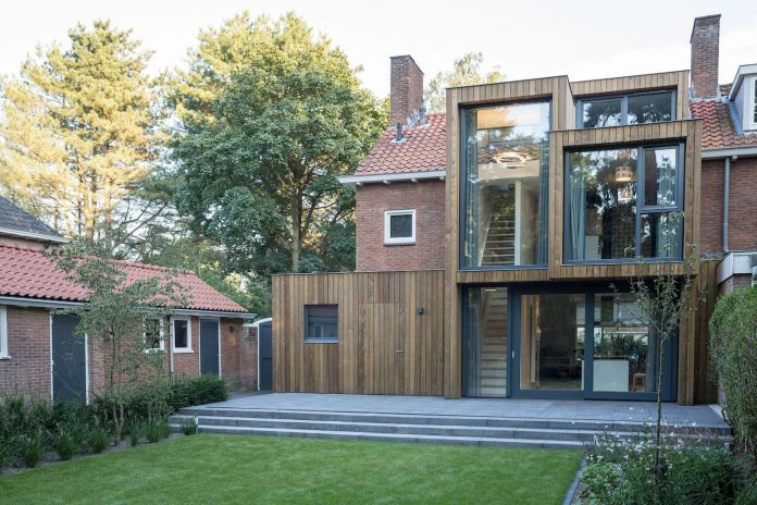A Timber Clad Extension Creates New Relationship Between Brick Semi detached House And Its