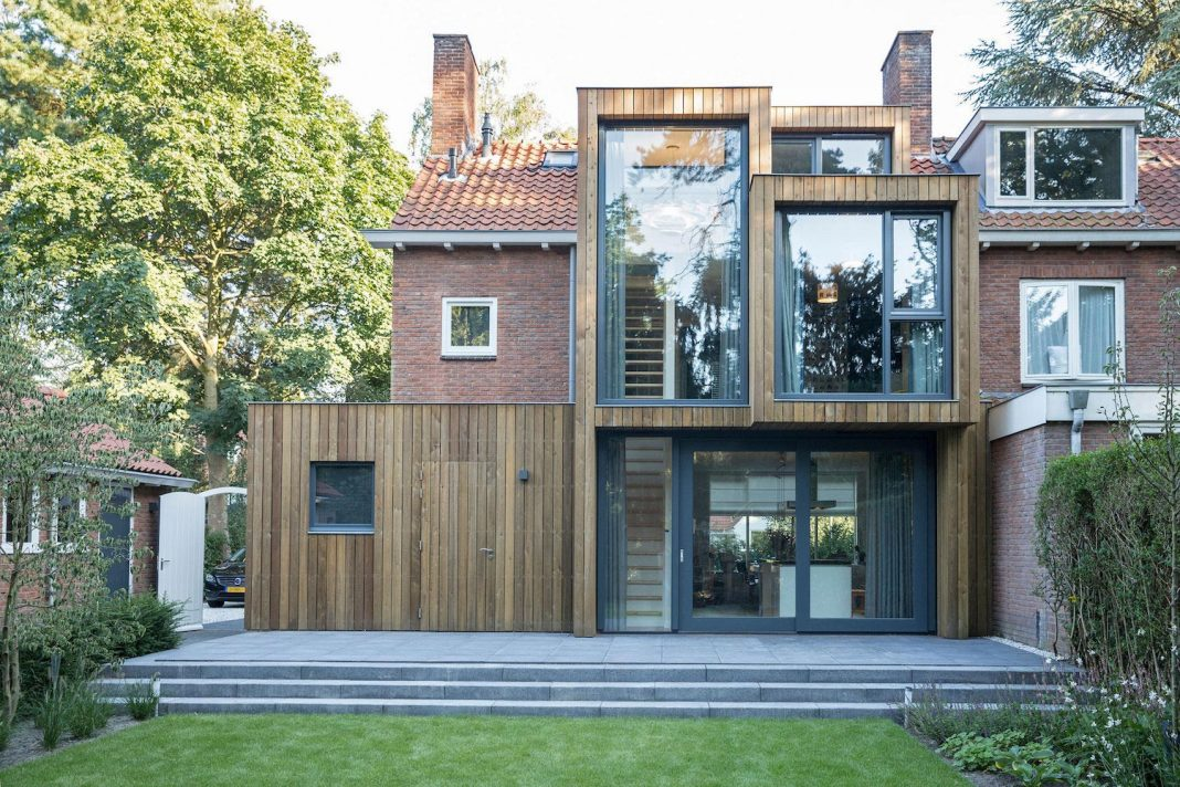 a timber clad extension creates a new relationship between a brick semi detached house and home design - New Brick Home Designs