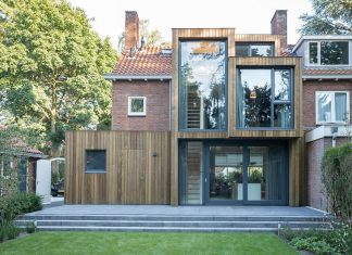 A timber clad extension creates a new relationship between a brick semi-detached house and its green surrounding