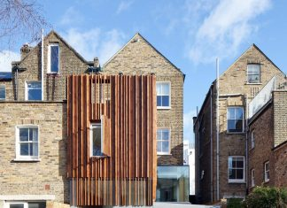 Typical London Victorian terraced house redesigned with highly sculptural timber clad rear extension