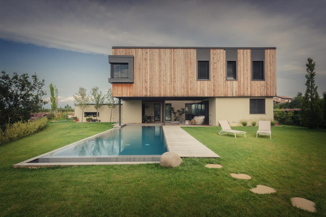 CLAB Architettura design the M house, placed in a little hill surrounded by vineyards