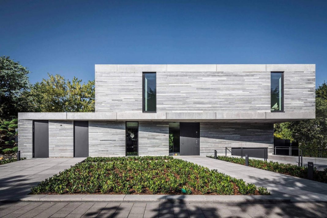 Contemporary Residential House Cologne Hahnwaldnatural covered in gray quartzite matte stone
