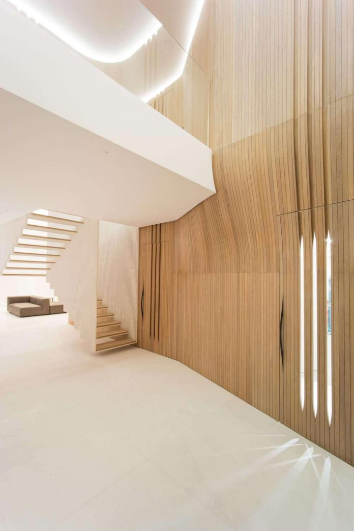 Penthouse Defined By A Cladded Wooden Skin And A Floating