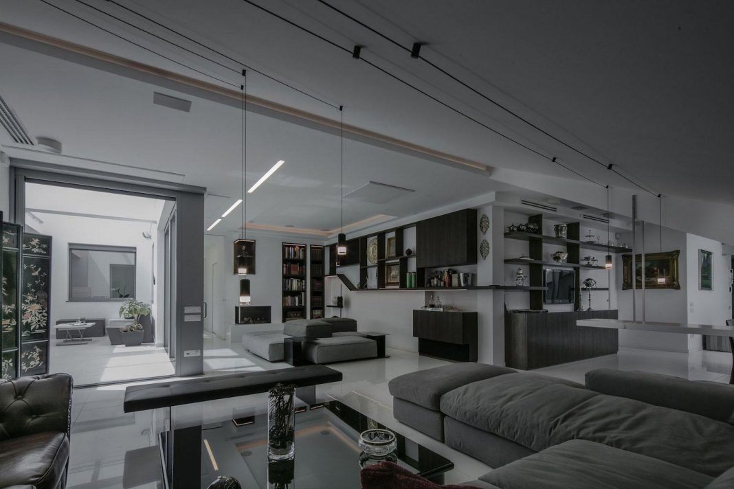 The reconstruction of an apartment on two levels by Sycamore Architects