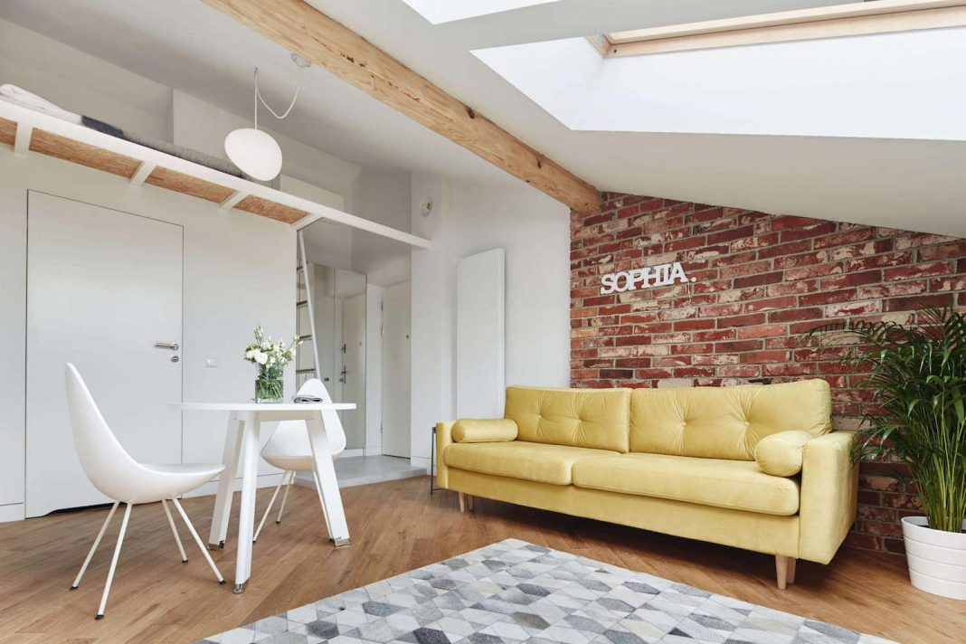 Sophia contemporary attic apartment designed by Blackhaus in Kraków