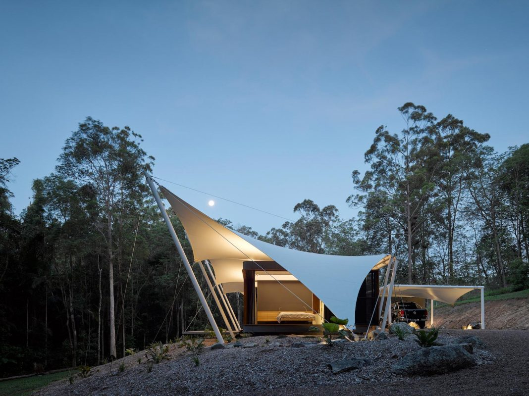 Tent House by Sparks Architects: a 3 bedroom home surrounded by lush tropical wall of trees