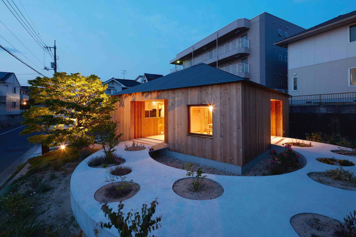 Unique home with beautiful wooden walls on its exterior in for Unique house exteriors