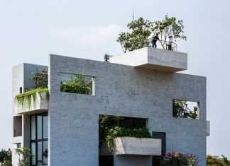 Binh House by Vo Trong Nghia Architects, an exposed concrete home that is also a house for trees