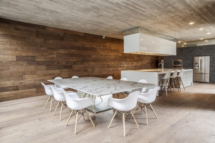 A concrete linear home with a wooden theme interior design find from the floor to the ceiling