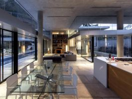 Guaparo House by NMD Nomadas, a contemporary concrete and glass residence