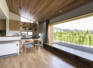 Teto Architects designed a house with a large landscape window open on beautiful rice field in Itoshima