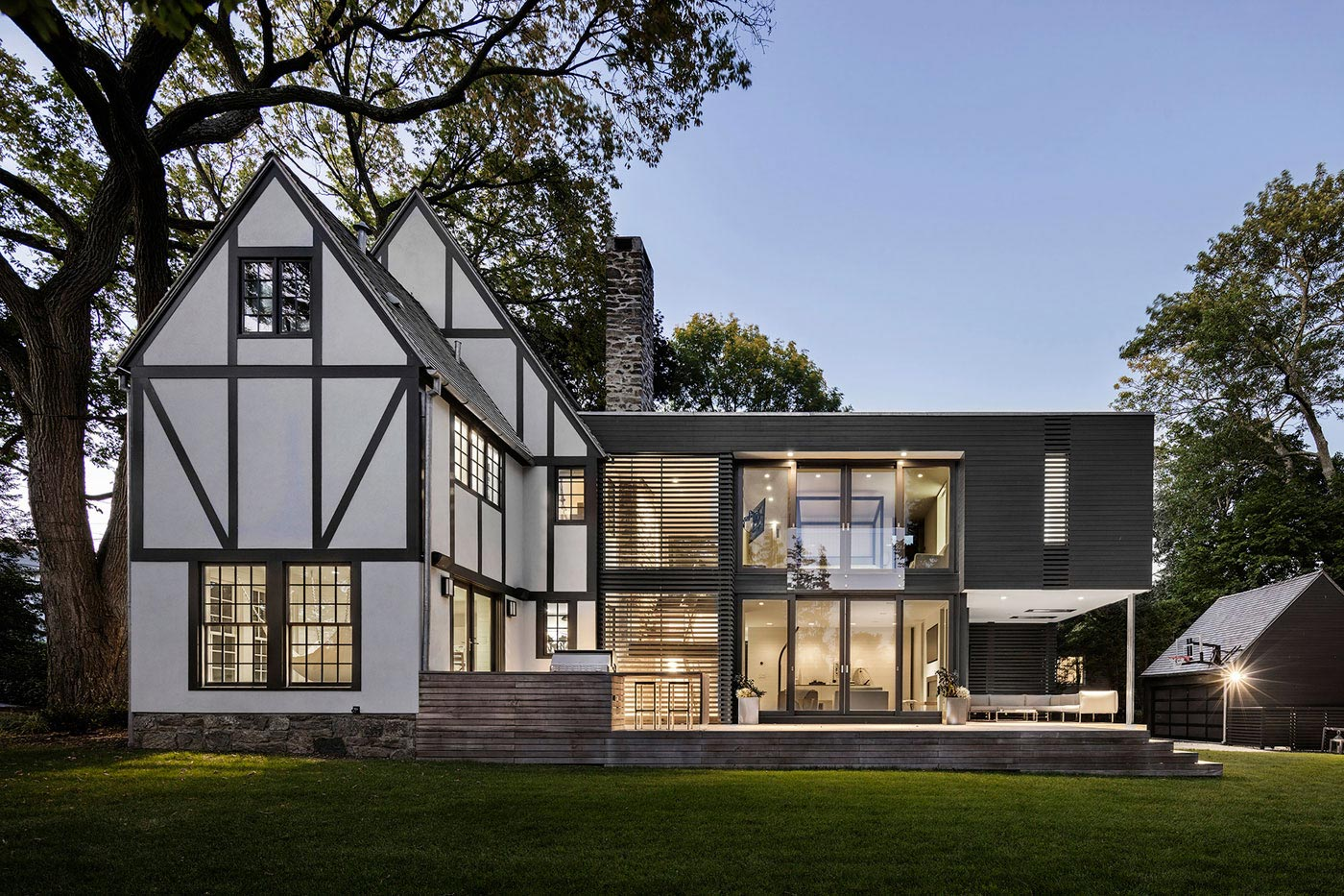 Renovation of a tudor style residence that is preserving for Modern house history