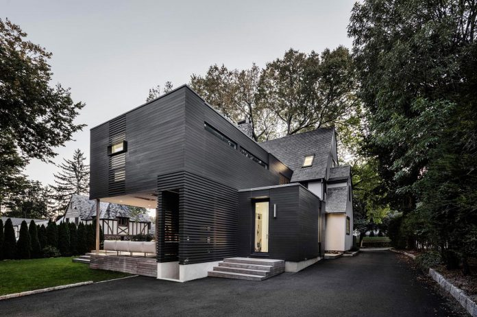 Old And New Architecture Design Relationship renovation of a tudor style residence that is preserving its