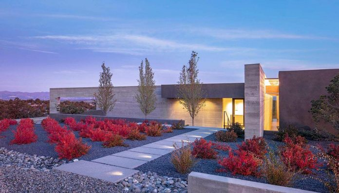 Ridge Top House In Santa Fe Is Organized Around Two
