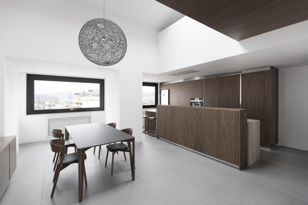 Studio DiDeA reconfigures a two levels penthouse to create a luminous and spacious space
