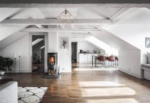Stylescale designed an Scandinavian attic apartment with old and new materials and decorations