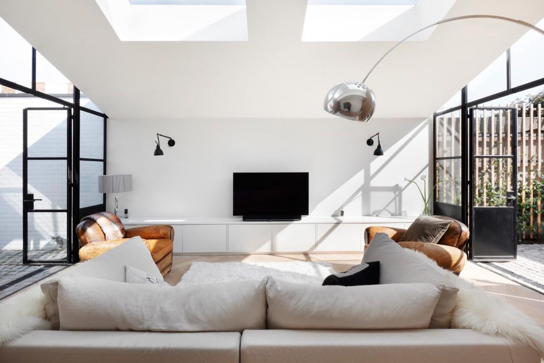 From single-storey storage garage to a beautiful two bedroom house that has skylights positioned above each family space