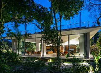 House close to the seashore and surrounded by a rich and dense rainforest vegetation