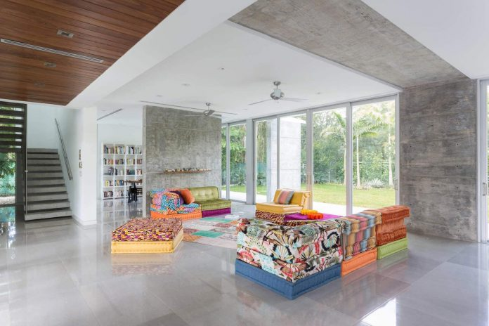 Inspiring Lacau Residence in Miami with many concrete elements and some colorful details