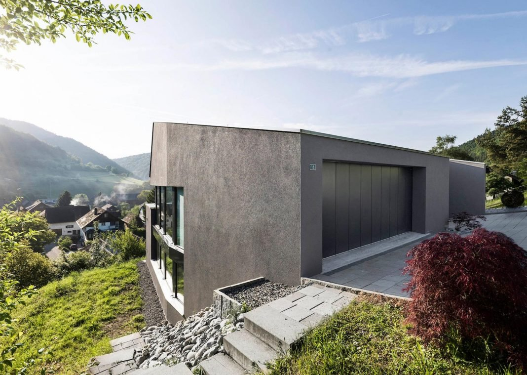 Single family house built on a steep slope that leads to for Steep hillside house plans