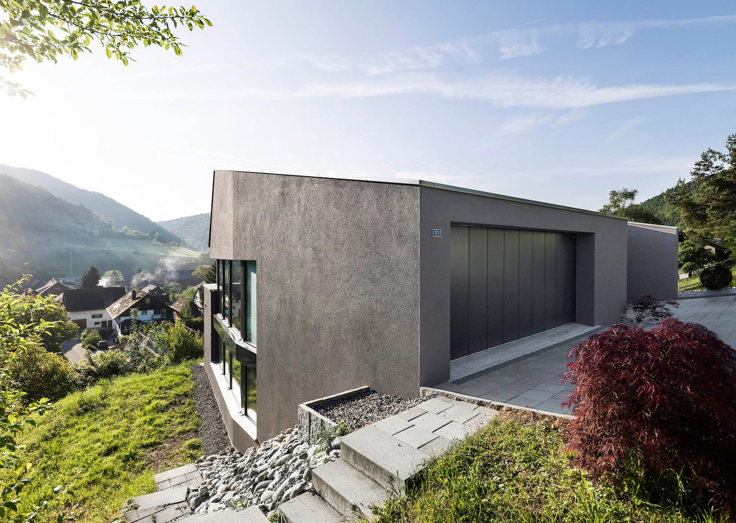 Single family house built on a steep slope that leads to