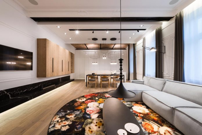 Stylish combination of new textures and materials with old elements of this historic apartment in Warsaw, Poland