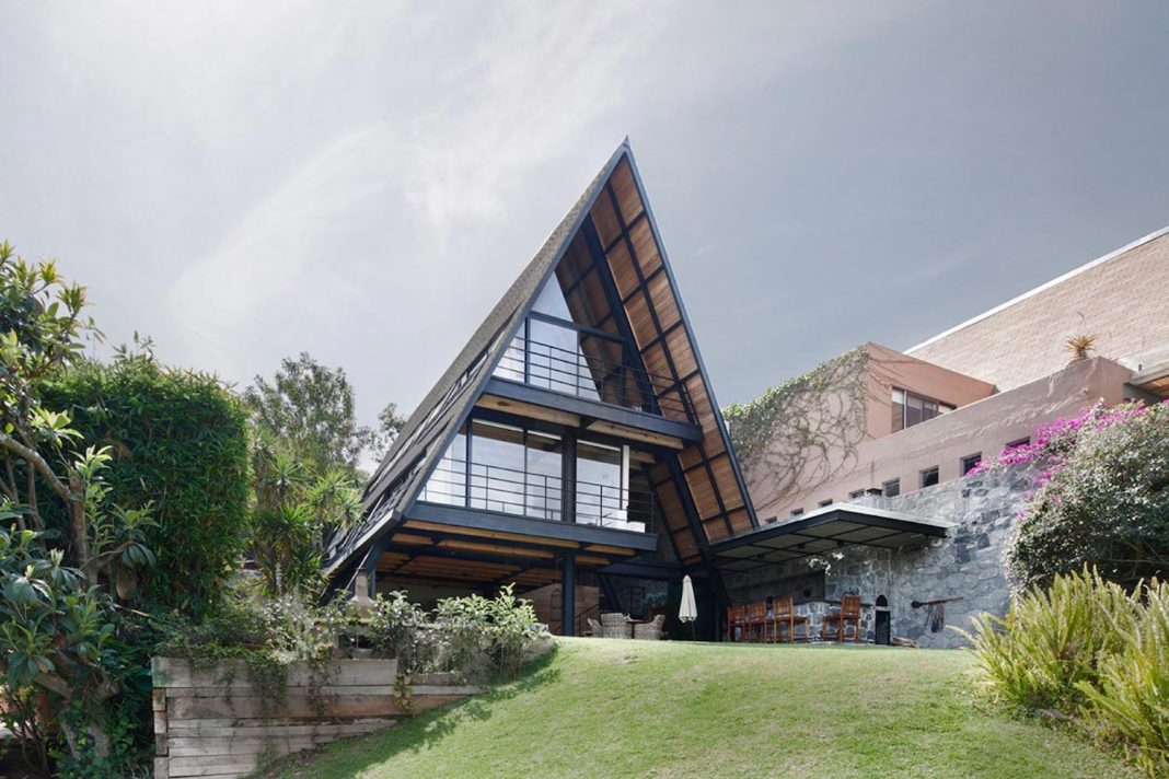 The A-frame shape is used to capture most of the beautiful natural surroundings