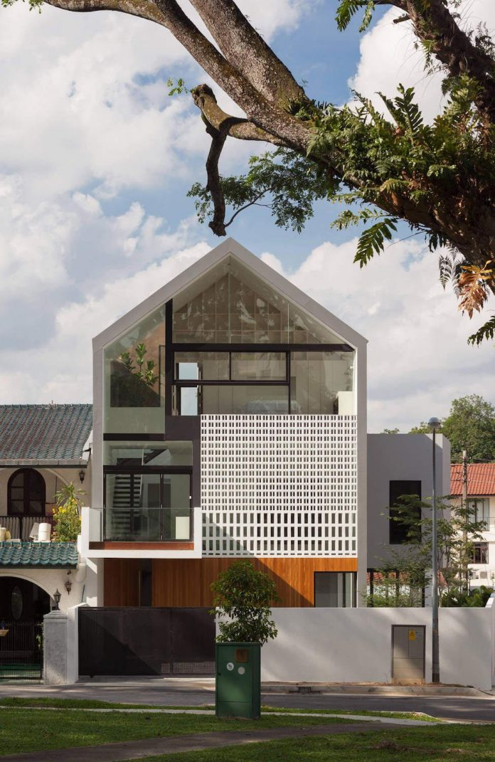 At the back, an open roof terrace cuts back the house massing above the  rear neighbors to take in views of the distant forest hill. Between this  two ends, ...