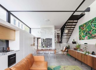 Traditional childlike idea of a gable roofed house is converted into this modern home design