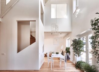 A two-storied house for a young family with the first floor opened