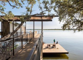 Vertically structured lake house responding to the site's steeply rising topography