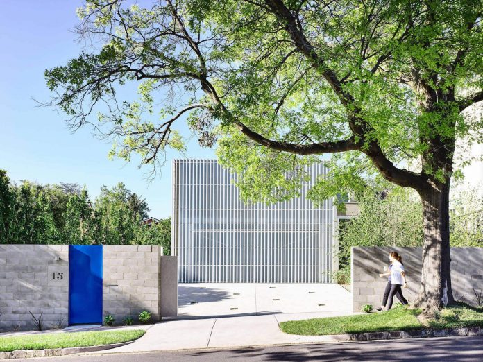 Moving House White Aluminium Screen Forms A Singular Mass