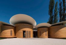 House of music: architecture blends with music and creates this 9 circular music workshops wrapped in oak wood