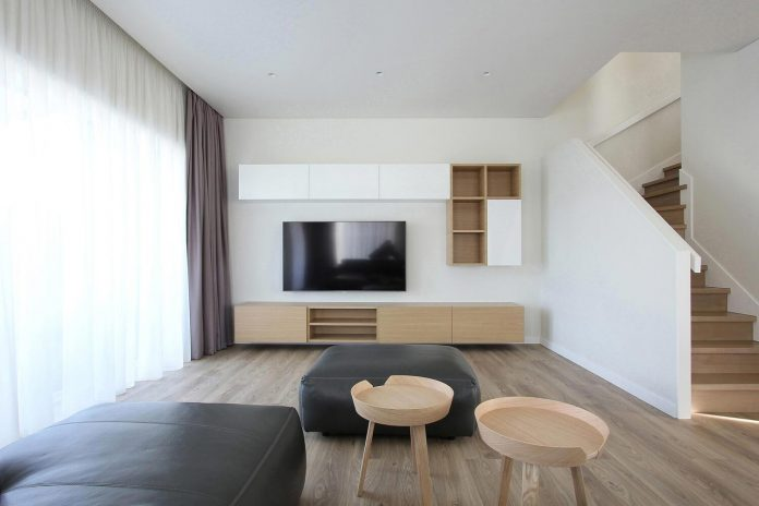 Bright with a pinch of minimalist style house in Klaipėda, Lithuania designed by Ramunas Manikas