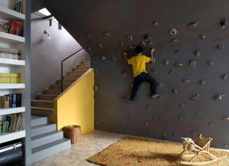 Fun home with lots of contrasting materials and colors has also a climbing wall inside it
