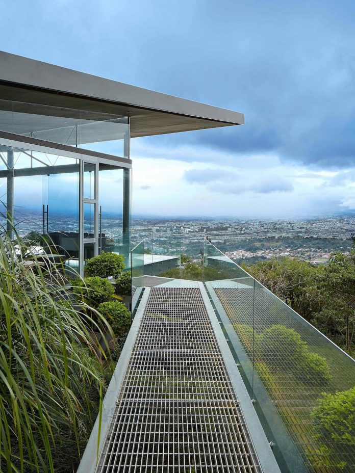 Glass House Elevated On Top Of Metallic Columns Has Also 3