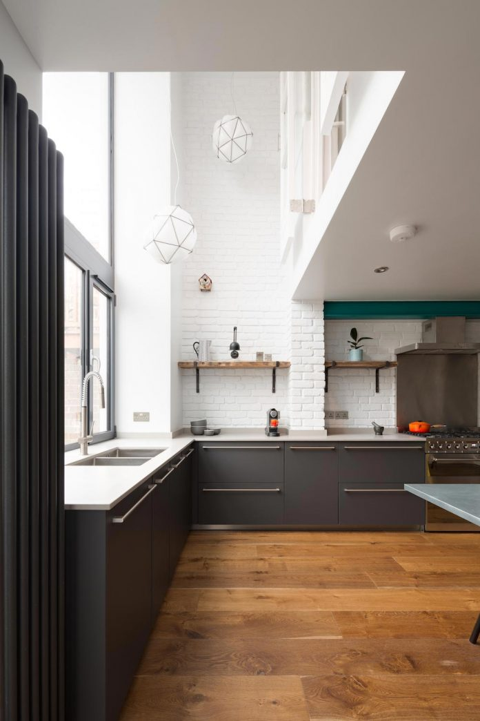 High Kitchen by A-Zero Architects: convert the basement to a new kitchen and bicycle workshop