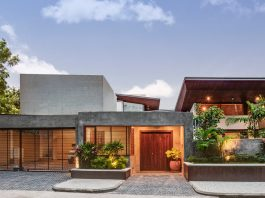 House 1058 by Khosla Associates: Cantilevered timber clad and staggered rooms oriented towards the internal garden