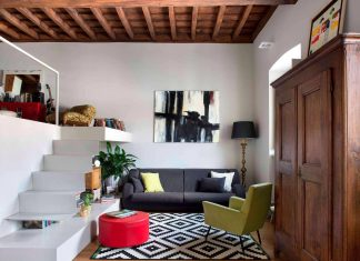 Modern meets traditional in this apartment located in a historic building in Paesana, Italy
