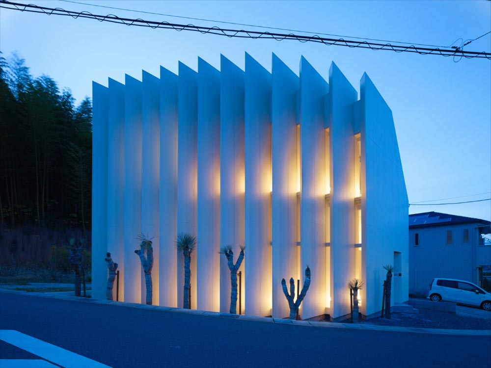 One continuous space with no partitions between rooms covered into 13 gigantic white louvers