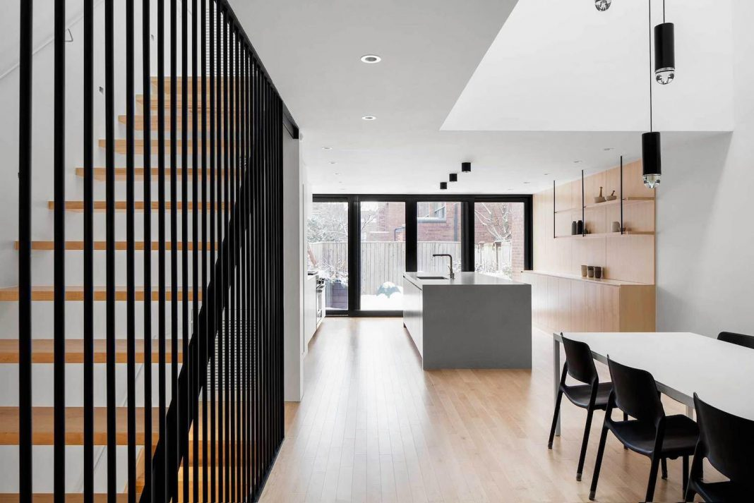 Somerville Residence by NatureHumaine: renovation a row house with a triple-height void topped by a skylight