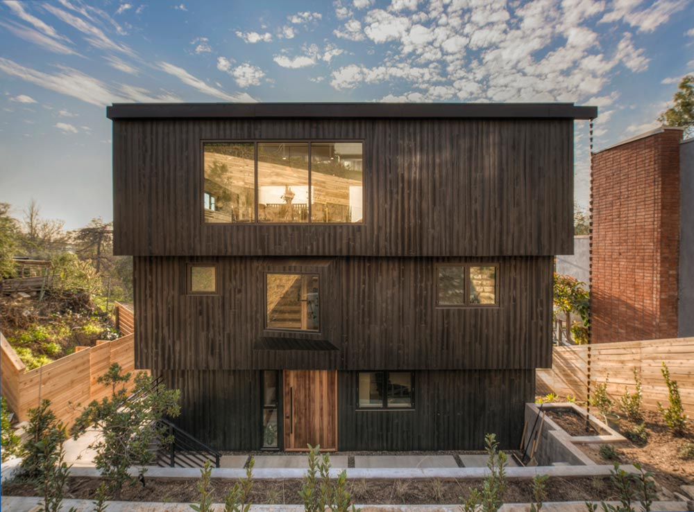 Three-story home bringing a sense of enclosure to the rear yard