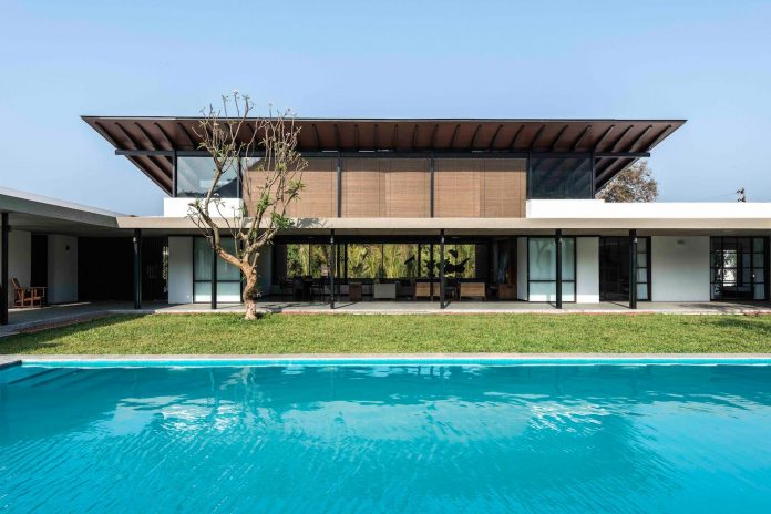Twin contemporary houses capturing the essence of place share the ...