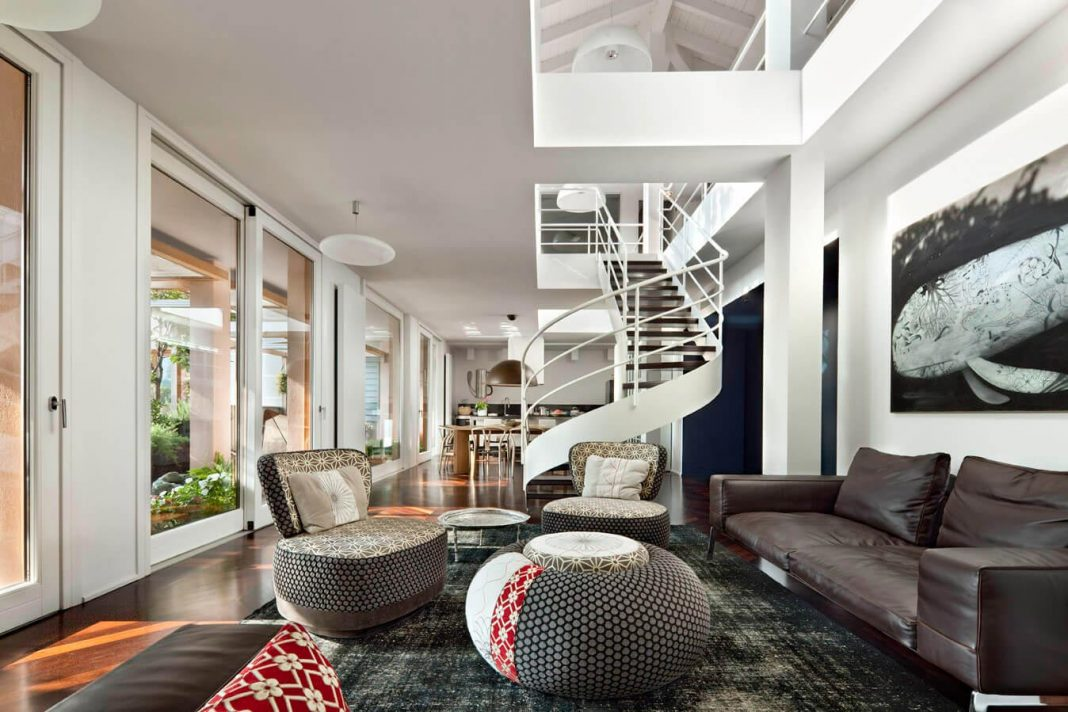 How to use the double height ceiling of a penthouse in a way that creates a sense of openness and transparency