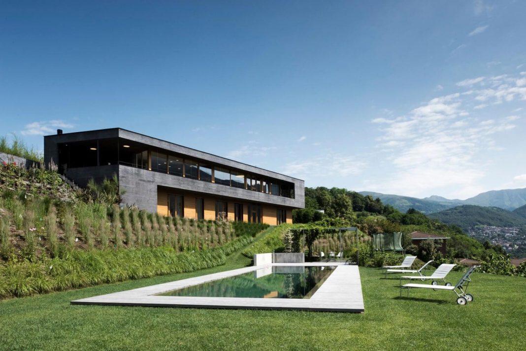 Villa Comano by Attilio Panzeri & Partners boasts a breathtaking view over the Lugano Lake